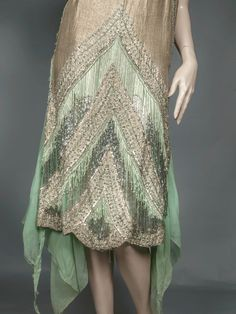 The beading consists of silver plaitlettes, silver seed beads, silver bugle beads and stunning green rose montees. Green silk and bugle bead fringe, a stunning scalloped motif terminating at the scalloped hem. 20s Fashion, Art Deco Fashion, Fashion History, Vintage Fashion, Edwardian Fashion, Couture Fashion, Fashion Dresses, 1920 Style, Flapper Style