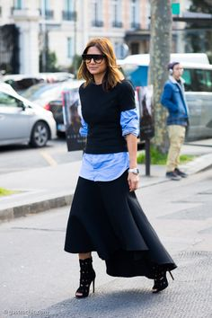 Long button-up under short sleeve sweater.  Christine Centenera in Paris.