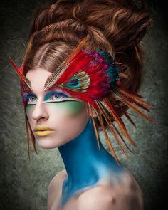 WOW this composition is great! Lady as bird, with help from makeup expert and photoshop