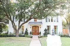 Fixer Upper Season 3 | Chip and Joanna Gaines Renovation | Chip 2.0 House | White Brick House | Front Door | Exterior Shutters