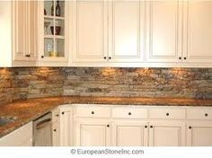 White cabinets with stone tile backsplash often pictured with lighter, stone-look/granite counters. Pictures Of Stacked Stone Backsplash - Kitchen Backsplash Ideas . - Peg It Board But with a black granite countertop Stacked Stone Backsplash, Herringbone Backsplash, Beadboard Backsplash, Natural Stone Backsplash, Hexagon Backsplash, Stone Tiles, Kitchen Redo, New Kitchen, Kitchen Remodel