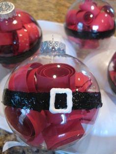 Adorable! Red paper curls in a clear ball ornament with some white and black paint to finish = cute Santa ornament!
