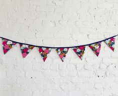 Floral bunting banner Bridal buntingPennant flag garland | Etsy Flag Garland, Fabric Garland, Fabric Bunting, Pennant Flags, Flag Banners, Bunting Banner, Bridal Shower Decorations, Dorm Decorations, Garden Bridal Showers