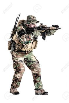 Picture of Special forces United States in Camouflage Uniforms studio shot. Holding weapons, wearing jungle hat, shooting on the move, attacking enemy. Studio shot isolated stock photo, images and stock photography. Navy Military, Military Humor, Military Guns, Military Life, Military Art, Military History, American Special Forces, Jungle Hat, Marsoc Marines