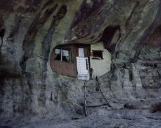 Dwellings carved out of cave walls post-apocalyptic survivalist fiction