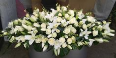 Coffin spray- white- lillies, roses, lisianthus, astilbe.