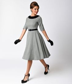 We are for real, gals! A glamorously retro inspired dress steeped in a glorious houndstooth, The Jackson Dress from Hell Bunny is a lightweight black and white frock with a stunning black velvet collar. Featuring elegant half sleeves and a princess seamed