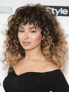 Bangs for Curly Textures - Choppy Baby Bangs (pictured: Ella Eyre) | allure.com