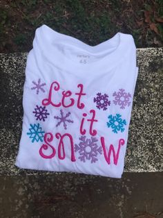 A personal favorite from my Etsy shop https://www.etsy.com/listing/261598940/let-it-snow-shirt