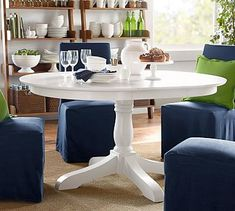 A simplified silhouette in artisanal white makes this table the perfect centerpiece in an eclectic dining room. Pair it with chairs in the same finish, or mix it with other pieces in contrasting colors and materials.