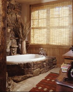 Chic Bathtub Surrounds look Other Metro Rustic Bathroom Image Ideas with bamboo shade decorative grass decorative stone natural wood neutral palette wainscoting