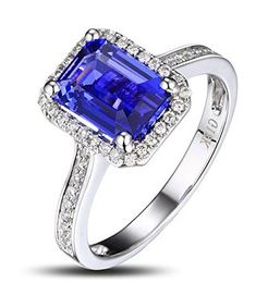 Antique Halo Emerald Cut Blue Sapphire and Diamond Engagement Ring - Vintage is the new Classic with this lovable Antique Halo Emerald Cut Blue Sapphire and Diamond Engagement Ring in 18k White Gold in a Designer setting with a Blue Sapphire Emerald cut center stone with White Round diamonds on the halo mount & channel style shank. The Antique Halo Emerald Cut Blue Sapphire and Diamond Engagement Ring comes with a gem weight of 1.50 carats. The diamonds are 100% natural…