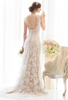 Brides: Essense of Australia. Lace sheath over a lustre satin slip with a beautiful v-neckline and cut-out portrait back.  More Details From Essense of Australia