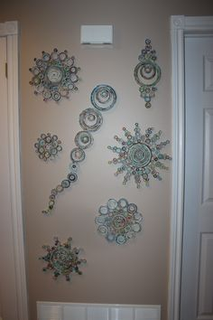 rolled paper art display in my hallway