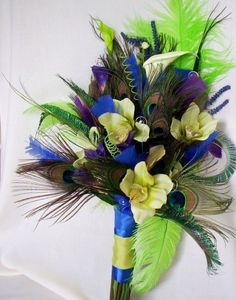 Wedding Peacock bouquet Royal blue Lime green Purple @Laurie Sichewski any of those colors with the blue you want would look gorgeous.