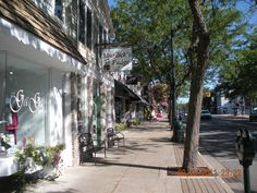 Streetscape in Charlevoix, MI - one of our favorite Michigan escapes. Mi One, State Of Michigan, Wide World, City Streets, Main Street, Small Towns, Vacation Spots, Vacations, Beautiful Places