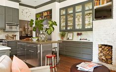love this kitchen by Lili O'Brien. charcoal cabinets, marble, honed blue limestone, exposed brick