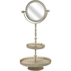 Open you foyer, powder room, or master suite d�cor with this lovely mirror.    Product: MirrorConstruction Material: Iron and mirrored glassColor: Antiqued whiteFeatures: Vanity mirror with two tier trayDimensions: 20.25 H x 9.75 Diameter