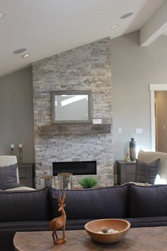 Stacked ledger stone gas fireplace with reclaimed barn beam mantel. Wall color Benjamin Moore Revere Pewter and Simply White trim.