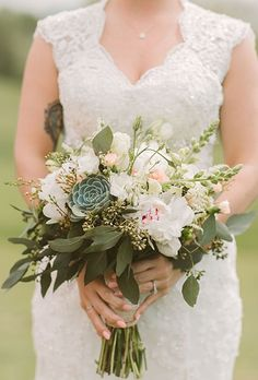Succulent Wedding Bouquet. Florist Elaine Pisarcik gave this bouquet of peonies and stock flowers a heatproof upgrade with the addition of green succulents.