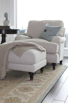 This chair for the family room! I would love to read a book curled up in the chair with a nice thunderstorm raging outside :)