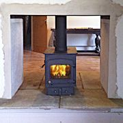 A double-sided stove fitted between two rooms