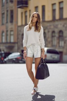 Metallic shorts and sandals with a white sweater