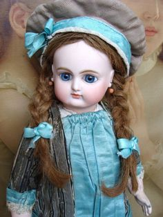 This is an andorable antique Petit & Dumoutier Bebe in a rare size 0.  Pale pressed bisque with unfortunatly an invisible hairline on the left side of
