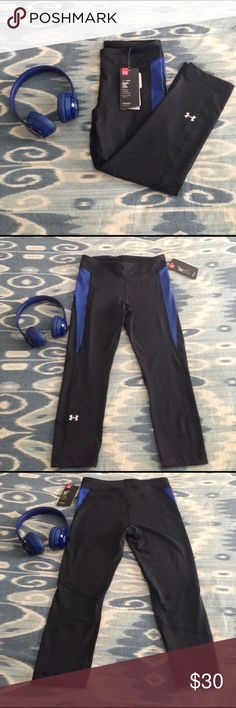 Under Armor Crop Yoga Pant Stretchy, comfortable Dry-fit compression material. Lining keeps you comfortable yet supported during your workout. Royal blue detail Under Armour Pants Leggings