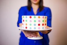 Learn how to decorate a three-layer cake with a colorful, modern fondant design.
