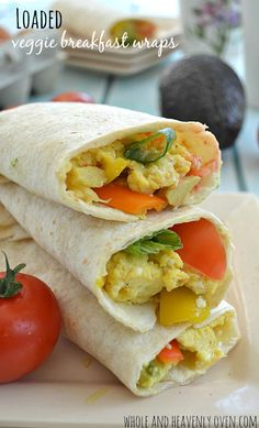 Jam-packed with veggies, eggs, and cheese; these fun breakfast wraps whip up in minutes and are perfect for an on-the-go breakfast! | wholeandheavenlyoven.com