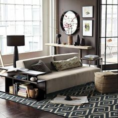 What can I say? West Elm catalog is really doing it for me right now. Long ikat pillow (subtle!), rug, and circular deep mirror are all desirable.