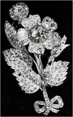 In 1944, Princess Elizabeth launched the ship HMS Vanguard & was presented with this antique diamond brooch by Messrs. John Brown, the shipbuilder. It is in the shape of a wild rose,  leaves & a stem tied with a small bow.