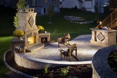 outdoor fireplace on a circular stone patio