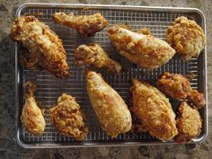 Fried Chicken : Ree's secret to getting chicken that's fried to golden-brown perfection and cooked through on the inside is starting the thigh and breast pieces in the oil, then letting them finish in the oven (the legs should be able to cook completely in the oil).