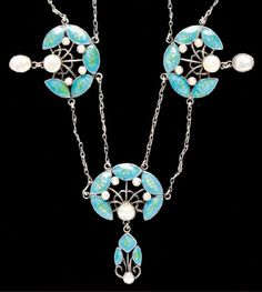 AN ART NOUVEAU SILVER AND ENAMEL NECKLACE. Naturalistically designed, enamelled in blue and green, set with seed pearls and mother of pearl.