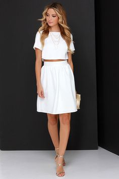 """Put your entire wardrobe in perfect harmony with one little set ... the You and Me Ivory Two-Piece Dress! Textured woven poly lays the foundation to this charming crop top with a bateau neckline, short sleeves, and a darted straight cut bodice. Complete the look with the high-rise skirt finished with delicate gathering, and a modest, midi length. Top and skirt have hidden zippers with clasps. Fully lined. Small top measures 14"""" long. Small bottom measures 20.5"""" long. 100% Polyester. Hand…"""