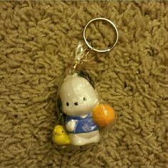 Pochacco Sanrio Keychain - NWOT Brand new with wrapping Price is firm. Sale - Bundle 3 keychains together for $15. Sanrio Accessories Key & Card Holders