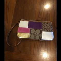 Coach Wristlet Small Coach Wristlet. Multi colored patches on the front and brown Coach C's on the back. Bags Clutches & Wristlets