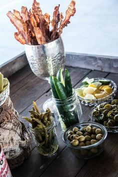 Debutante Farmer Bloody Mary Bar with all the fixins including: bacon, cucumbers, olives, pickled okra and green beans