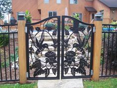 A wonderfully detailed iron gate, more work by Molnar Metal Art.