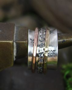 Spinner Ring Serenity by charmedlifedesigns on Etsy, $52.00 Or this one!!