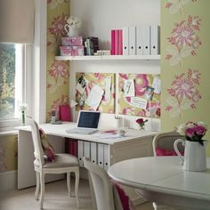 Alcove home office with pull-down desk and floral pin boards
