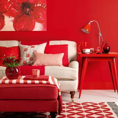 living room, Cozy Living Room Design Red Wall And Furniture Adorned Red Flower Painting Art: Creating a warm living room with red color accents