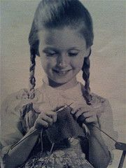 Learning to knit......Mum taught me to knit at a young age. I was able to knit outfits for my doll's. Still love to knit :)