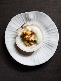 Diver scallop, cauliflower, Meyer lemon, brown butter by chef Michael Tusk. © Maren Caruso. - See more at: http://theartofplating.com/gallery/?home=1&link=post-376#gallery32511