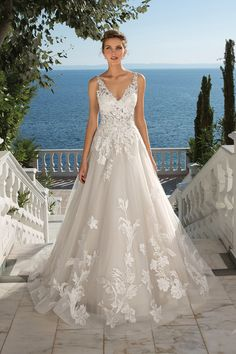 You will be a true bridal vision wearing this tulle ball gown adorned in Venice lace appliques from head to toe. Button and loop closures line the back. This style is also available with the front bodice lined to the side seams.