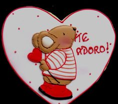 "Valentine's day ""I adore you "" cookie by 	Patricia Nuñez. If you copy this little mouse, notice the head and feet pointing in a backward position so make sure you draw the hand with the thumb down and not like shown in this picture"
