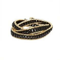 Morgan Black The Morgan wrap bracelet embodies bohemian opulence. A long track of wooden beads, leather cord and 18k gold plated box chain are hand-woven together to make this an easy everyday bracelet. Be free and luxurious! - 18k gold plated, wooden beads, leather