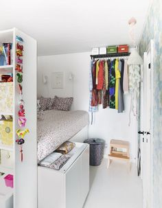 Mette Helena displays her most colourful clothes on a wall-hung hat rack to brighten her space https://www.ikeafamilylive.com/en/home-story/small-is-beautiful-97#photo-1364